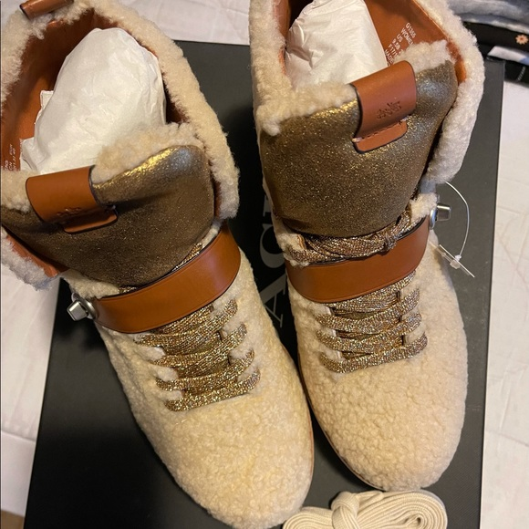 Brand new coach boots size 9 1/2